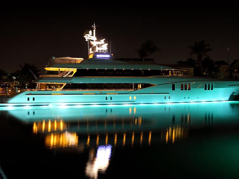 superyacht in the water with lighted bottom